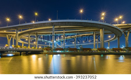 Industrial Ring road overpass waterfront at twilight, Bangkok Thailand - stock photo