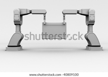 industrial robotic arms holding a frame - stock photo
