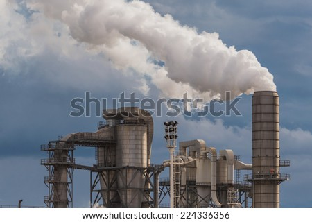 industrial scene with chimneys and stormy sky