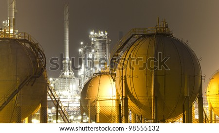 Industrial scenery at night - stock photo
