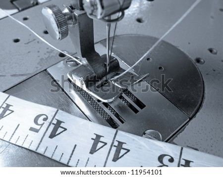Industrial sewing machine close up - stock photo