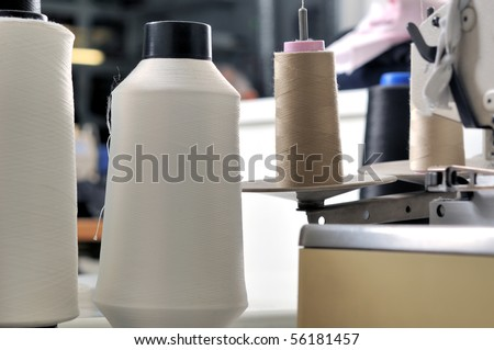 Industrial sewing machine close up - a series of TAILOR related images. - stock photo