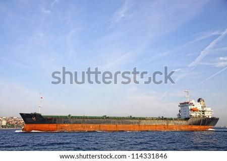 Industrial ship at Bosphorus strait in Istanbul, Turkey - stock photo