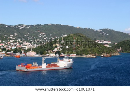 Industrial ship carrying packages - stock photo