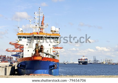 Industrial ship  in the harbor of rotterdam - stock photo