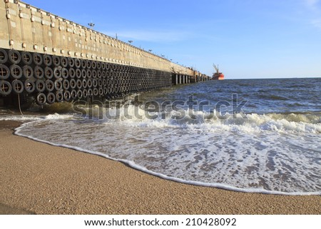 industrial ship port used old truck tire as guard protect port structure from sea wave