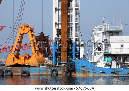 Industrial ship that digs sand - stock photo