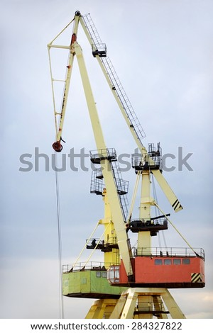 Industrial shipping cranes for containers in a port - stock photo