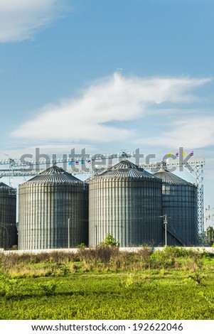 Industrial silos in the fields - stock photo