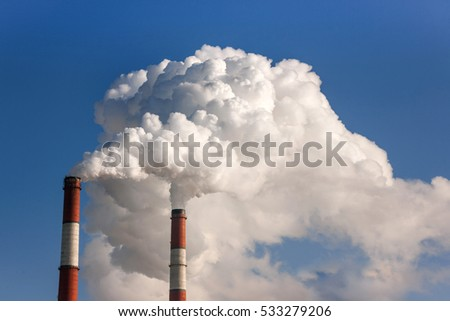 industrial site with smoking pipes, global warming concept