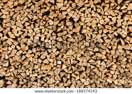 Industrial size pile of split beech wood logs - stock photo