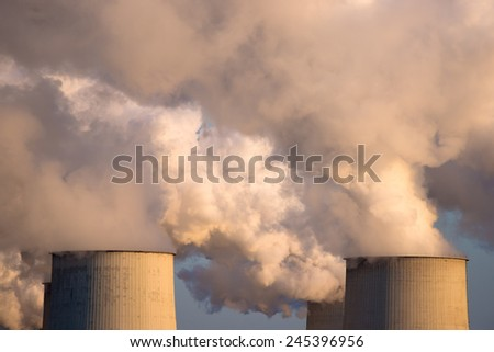 Industrial smoke from chimney on sunset - stock photo