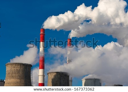 Industrial smoke rising from Power Station Cooling Towers