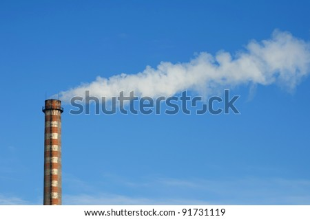 Industrial smoking chimney on blue sky. Thermal Power Plant - stock photo