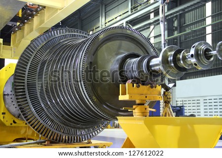 Industrial steam turbine at the workshop - stock photo
