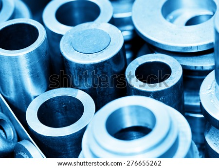 Industrial steel cylinders, pistons and tools in workshop. Industry theme. - stock photo