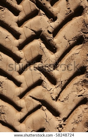 industrial tractor footprint on beach golden sand - stock photo