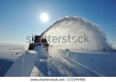 industrial truck cleaning in winter - stock photo
