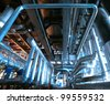 industrial valves and pipes against blue sky - stock photo