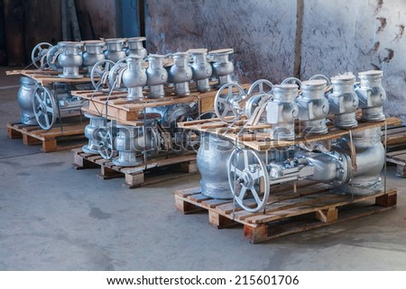 Industrial valves ready for dispatch on Euro palletes - stock photo