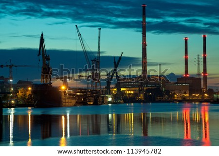Industrial view at sunset in shipyard of Gdansk, Poland. - stock photo