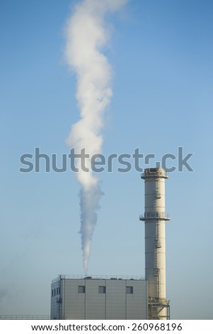 Industrial view of factory and smoke pollution - stock photo