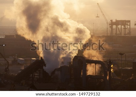 Industrial view with a smoke in a morning light (Tampa, Florida).