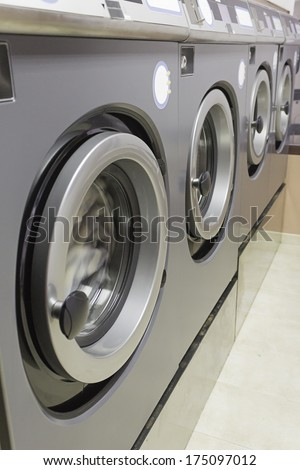 Industrial Washing in public shop, business and laundry - stock photo