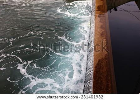 Industrial waste water discharge - stock photo