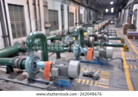 Industrial water pump station defocused abstract background   - stock photo