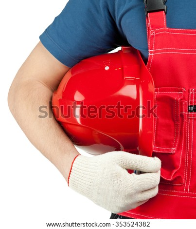 Industrial worker in uniform holding hardhat isolated on white - stock photo