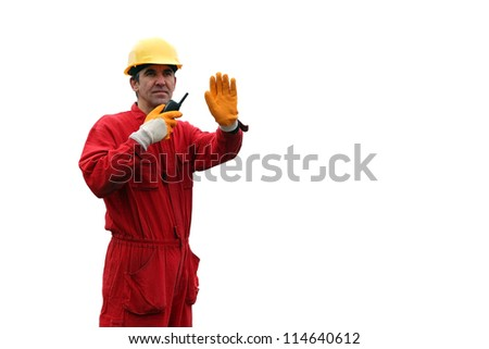Industrial Worker - Isolated Over White Background. A portrait of a worker in red overalls and yellow helmet with talkie-walkie. - stock photo