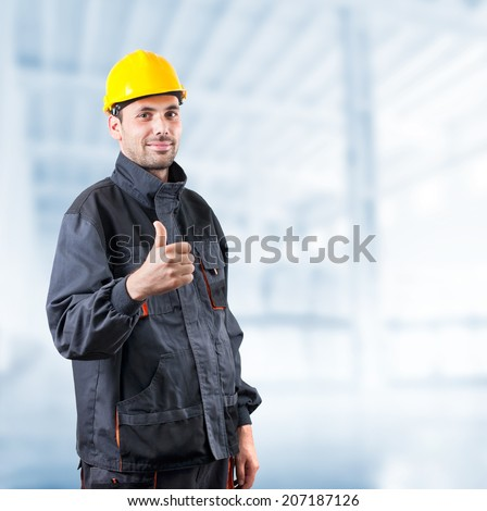industrial worker with thumbs up on white background