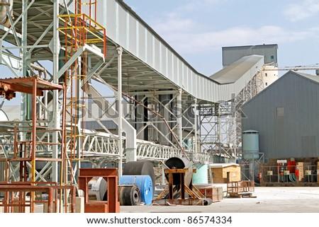 Industrial zone conveyor belt system on gold mine - stock photo
