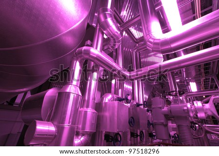 Industrial zone, Steel pipelines and cables in red tones - stock photo
