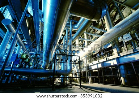 Industrial zone, Steel pipelines and equipment in blue tones - stock photo