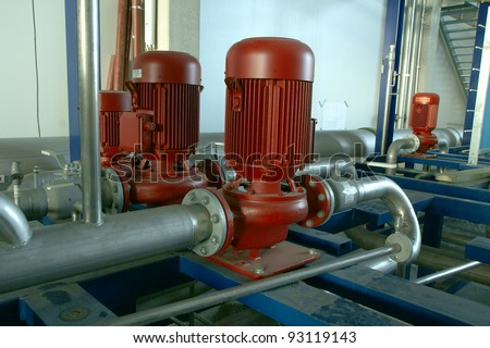 Industrial zone, Steel pipelines and pumps at factory - stock photo