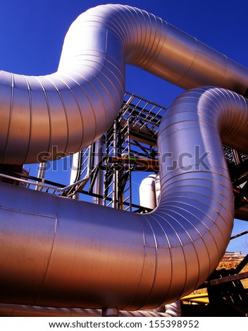Industrial zone, Steel pipelines at sunset          - stock photo
