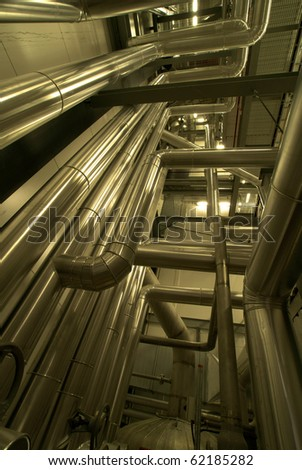 Industrial zone, Steel pipelines in yellow tones - stock photo