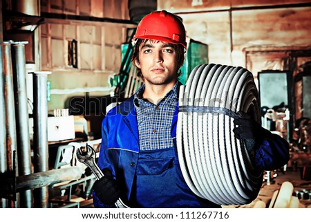 Industry: a worker at a manufacturing area. - stock photo