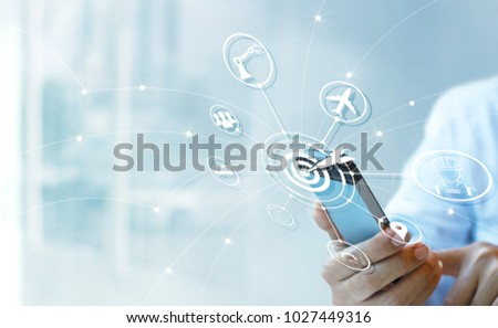 Industry 4.0 concept, Businessman using smartphone with icon target and data networking exchange in manufacturing technologies on virtual modern interface.