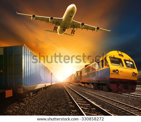 industry container trains running on railways track and cargo freight plane flying above against beautiful sun set sky use for land transport and logistic business  - stock photo