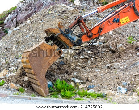 Industry, heavy duty excavator machine, digger bucket bulldozer shovel on construction site outdoor - stock photo