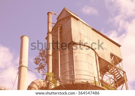 Industry in Norway, Hordaland county. Odda steel mill, abandoned factory. Filtered color style. - stock photo