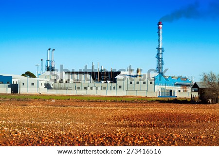 industry plant  under clear blue sky  - stock photo