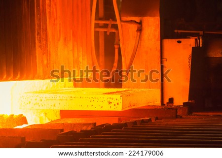 Industry steel, Hot slab extracting from Furnace. - stock photo