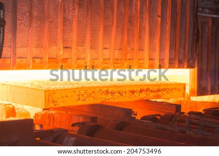 Industry steel, Hot slab is extracting from furnace. - stock photo
