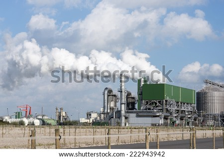 industry with pollution vessels pipes and other equipment in europoort rotterdam - stock photo