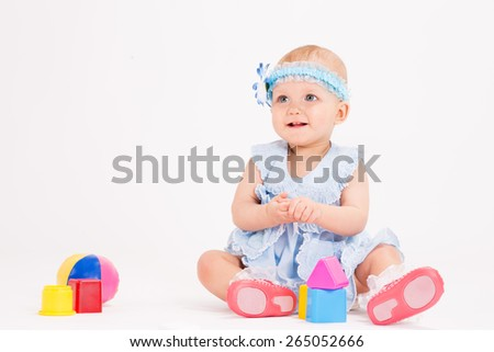 infant age ten months on a white background