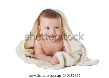 Infant, baby in towel is isolated on a white background. - stock photo